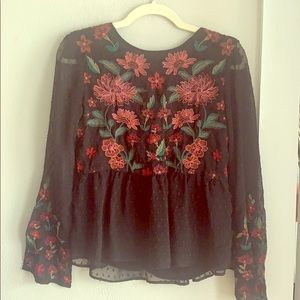 Long sleeved black blouse with colorful detailing